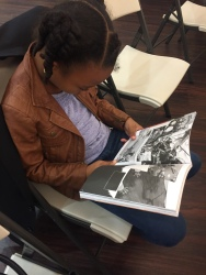 "Tanika Spates' daughter enjoying reading ""March: Book One"" co-authored by Rep. John Lewis and Andrew Aydin."